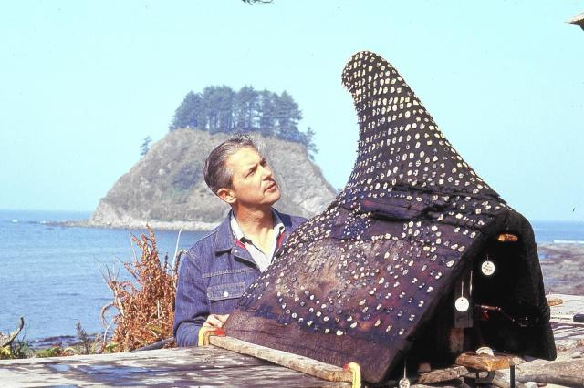 """Richard Daugherty with the famous """"whaling trophy"""" from the Ozette Site.  Source: Washington State University."""