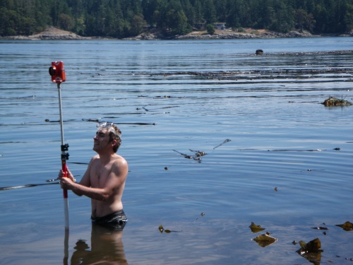 UVIC field school student helping map in a clam garden on Russell Island, Salish Sea.
