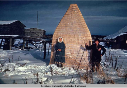 "Title from caption. Handwritten note reads ""Kwithluk fish trap [Kwethluk]."" Alaska Native man and woman pose in front of a structure identified as a fish trap. Kwethluk, SW Alaska. Source: http://vilda.alaska.edu/cdm/singleitem/collection/cdmg11/id/12049/rec/25"