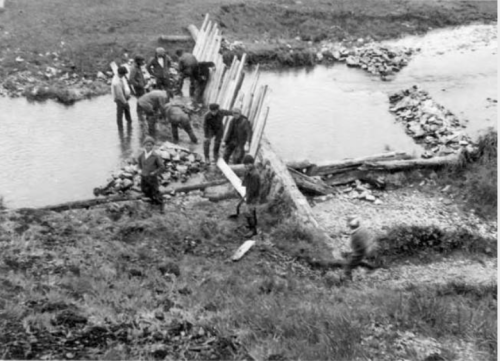"""The Natives have been busy erecting a fish trap"" reads the slightly condescending title. Nikolski, Aleutians, ca. 1938. Source: http://vilda.alaska.edu/cdm/singleitem/collection/cdmg13/id/7678/rec/38"