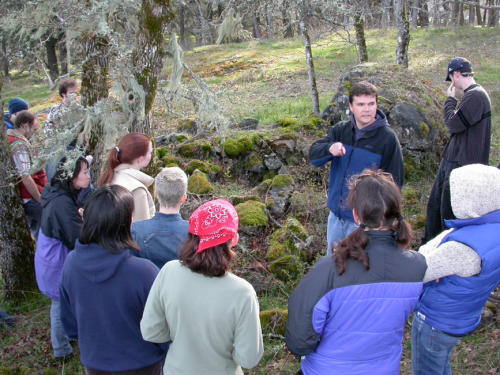 Darcy Matthews leading a UVic field trip to burial features in Metchosin.  Photo:qmackie