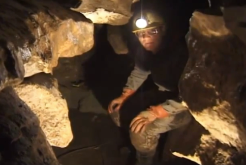 Tim Heaton at work in OYK cave.  Screenshot from video.