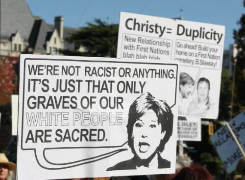 Signs condemning BC Premier Christy Clark at a rally at the BC Legislature. Source: Grace Islet facebook page.