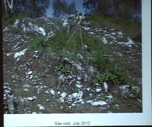 Human burial cairn with soil stripped to its perimeter as part of hoyse development site preparation. Source and description: video of lecture given by Chris Arnett.
