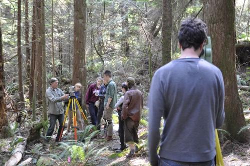 Gary Coupland (left) training students on transit use and archaeological survey/mapping. Photo: shíshálh blog.
