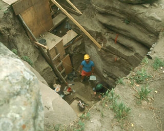 Deep excavations outside Charlie Lake Cave. Source: SFU.