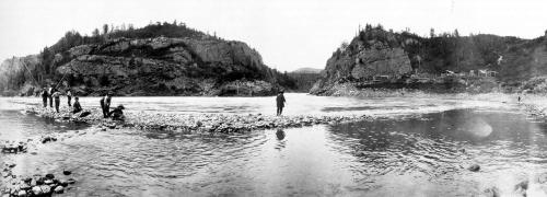 Stone wall fishing structure being used near Hagwilget, LowerBulkley River near Skeena River, Wet'suwet'en Territory, ca. 1910. Source: BC Archives
