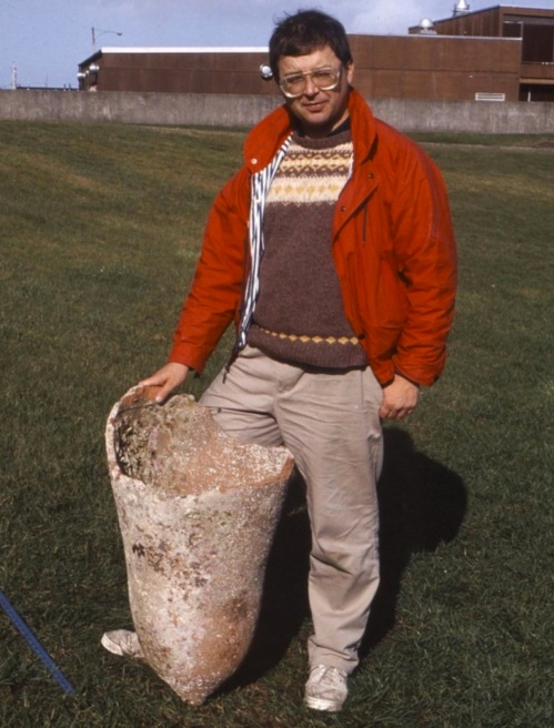 Tom Beasley with olive jar from seafloor near Langara Island. Source: Northword Magazine.